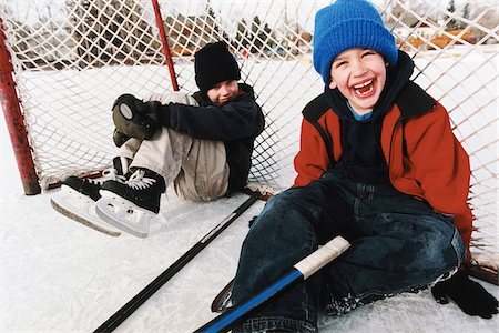 Portrait of Two Boys Sitting in Hockey Net at Outdoor Ice Rink Stock Photo - Rights-Managed, Code: 700-07199502