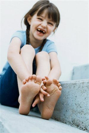 Portrait of Girl Missing front Teeth, Sitting Outdoors Stock Photo - Rights-Managed, Code: 700-07199529