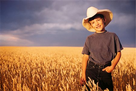 Portrait of Boy Standing in Wheat Field, Wearing Cowboy Hat Stock Photo - Rights-Managed, Code: 700-07199535