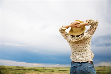 Woman Looking over Horizon, Alberta, Canada Stock Photo - Rights-Managed, Code: 700-07199667