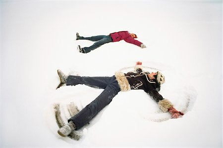 Women Making Snow Angels Stock Photo - Rights-Managed, Code: 700-07199668