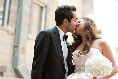 Portrait of Bride and Groom Kissing Outdoors Stock Photo - Rights-Managed, Code: 700-07199762
