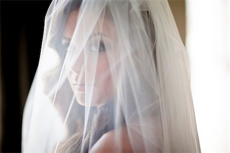Close-up portrait of bride with wedding veil over face, Ontario, Canada Stock Photo - Rights-Managed, Code: 700-07199829