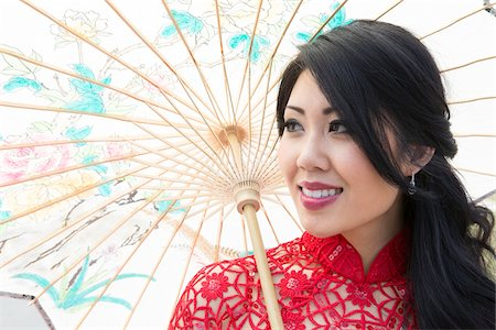 Close-up portrait of young woman holding Chinese parasol, Ontario, Canada Stock Photo - Rights-Managed, Code: 700-07199848