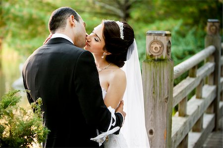 Bride and groom kissing outdoors in public garden, in Autumn, Ontario, Canada Stock Photo - Rights-Managed, Code: 700-07199869