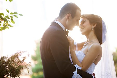 Close-up portrait of bride and groom standing outdoors, face to face, smiling and embracing, Ontario, Canada Stock Photo - Rights-Managed, Code: 700-07199861