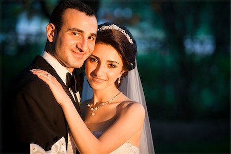 Close-up portrait of bride and groom embracing, smiling and looking at camera, Ontario, Canada Stock Photo - Rights-Managed, Code: 700-07199872