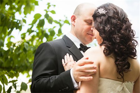 ring hand woman - Close-up portrait of bride and groom standing outdoors, face to face, Ontario, Canada Stock Photo - Rights-Managed, Code: 700-07199881