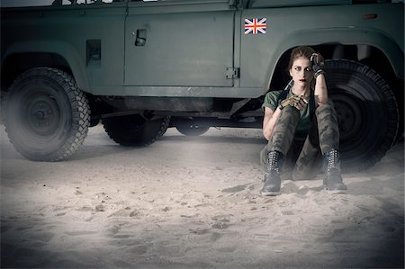 Woman Soldier Sitting on Ground by Military Vehicle Stock Photo - Rights-Managed, Code: 700-07192127