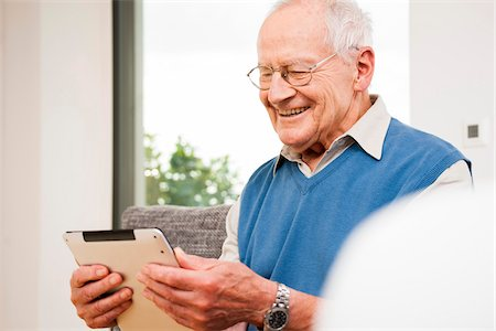 Portrait of Senior Man using Tablet Computer, Mannheim, Baden-Wurttemberg, Germany Stock Photo - Rights-Managed, Code: 700-07192188