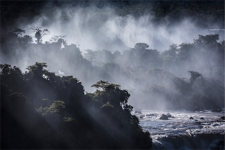 dreamy - Scenic view of Iguacu Falls with streaming rays of light, Iguacu National Park, Parana, Brazil Stock Photo - Rights-Managed, Code: 700-07204183