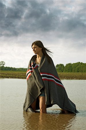 Young Women Wrapped in Blanket Standing in Large Puddle in the Country. Stock Photo - Rights-Managed, Code: 700-07206707