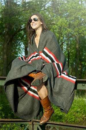 Young Woman sitting on Fence Wrapped in Blanket. Stock Photo - Rights-Managed, Code: 700-07206702