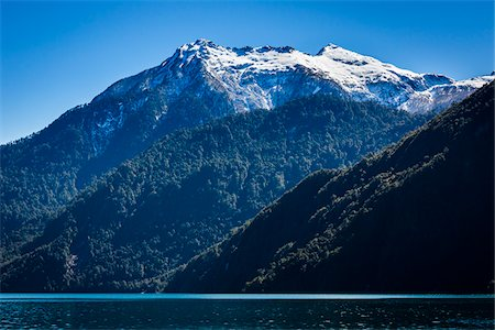 Scenic view of mountains and lake, Lake Todos los Santos, Parque Nacional Vicente Perez Rosales, Patagonia, Chile Stock Photo - Rights-Managed, Code: 700-07202718