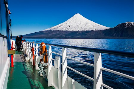 Close-up of tour boat on Cruce Andino, looking toward Osorno Volcano, Lake Todos los Santos, Parque Nacional Vicente Perez Rosales, Patagonia, Chile Stock Photo - Rights-Managed, Code: 700-07202720