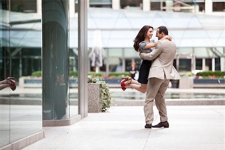 Excited couple embracing on ciity street sidewalk, Toronto, Ontario, Canada Stock Photo - Rights-Managed, Code: 700-07203958