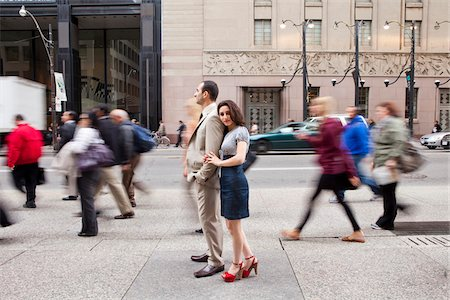 Couple standing on sidewalk on busy, city street, Toronto, Ontario, Canada Stock Photo - Rights-Managed, Code: 700-07203959
