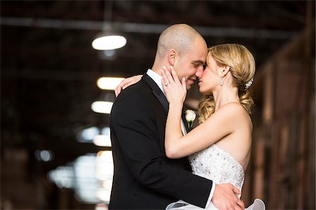 Bride and groom embracing at wedding venue on Wedding Day, Canada Stock Photo - Rights-Managed, Code: 700-07237585