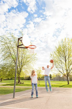 playing - Young couple playing basketball together in neighbourhood park in Spring, Tornoto, Ontario, Canada Stock Photo - Rights-Managed, Code: 700-07237605