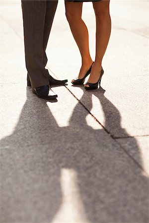 female feet close up - Close-up of young couples legs and feet with shadows, wearing dress shoes and standing on sidewalk, Canada Stock Photo - Rights-Managed, Code: 700-07237606