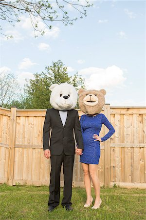 shimmering - Portrait of couple standing in backyard dressed in formal attire, covering faces wearing costume bear heads, Canada Stock Photo - Rights-Managed, Code: 700-07237603