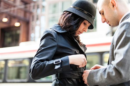 south american woman - Man Helping with Belt of Woman's Coat, Toronto, Ontario, Canada Stock Photo - Rights-Managed, Code: 700-07237830