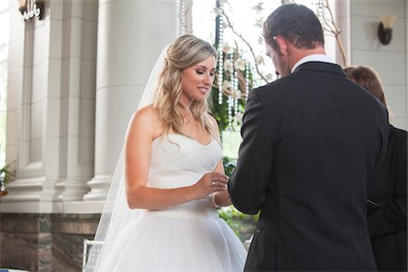 ring hand woman - Bride and Groom exchanging vows and rings at Wedding ceremony, Canada Stock Photo - Rights-Managed, Code: 700-07232325