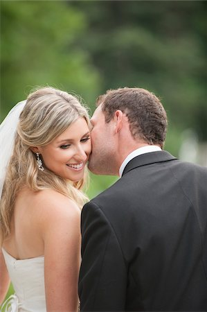 Close-up of Groom kissing Bride on cheek on Wedding Day outdoors, Canada Stock Photo - Rights-Managed, Code: 700-07232333