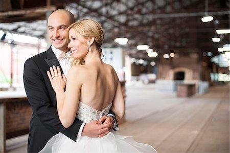 ring hand woman - Close-up portrait of bride and groom standing in banquethall, smiling and embracing, Canada Stock Photo - Rights-Managed, Code: 700-07232344