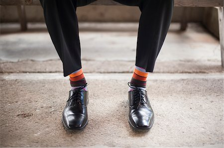 shimmering - Close-up of men's dress shoes with striped socks, Canada Stock Photo - Rights-Managed, Code: 700-07232345