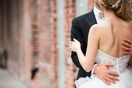 Close-up of Bride and Groom embracing outdoors on Wedding Day, Canada Stock Photo - Rights-Managed, Code: 700-07232346