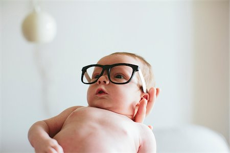 funny looking people - Three week old baby boy wearing glasses and being held in mother's hand inside home, USA Stock Photo - Rights-Managed, Code: 700-07240915