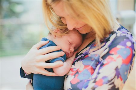 Close-up portrait of mother holding her baby boy, USA Stock Photo - Rights-Managed, Code: 700-07240916