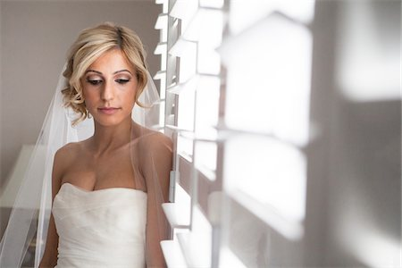 Portrait of Bride Indoors by Window, Toronto, Ontario, Canada Stock Photo - Rights-Managed, Code: 700-07278724