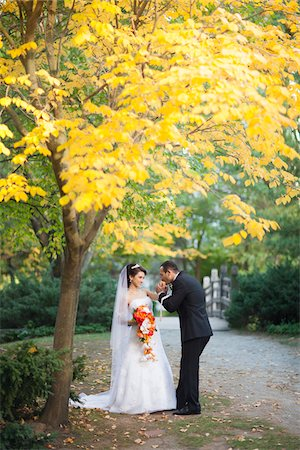 Portrait of Groom Kissing Bride's Hand Outdoors, Toronto, Ontario, Canada Stock Photo - Rights-Managed, Code: 700-07278720