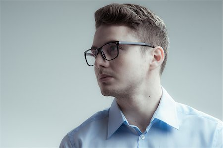 person silhouette face - Close-up portrait of young man wearing eyeglasses and blue shirt, looking to the side, studio shot on white background Stock Photo - Rights-Managed, Code: 700-07278871