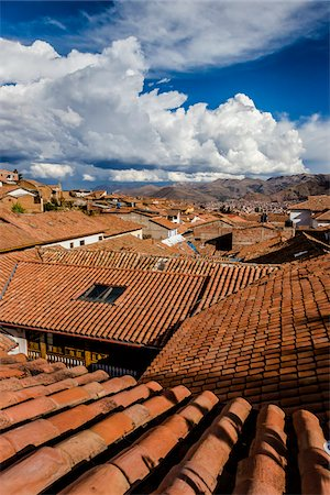 Overview of rooftops of homes with dramatic clouds, Cusco Peru Stock Photo - Rights-Managed, Code: 700-07279100