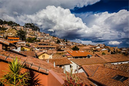 peru and culture - Overview of rooftops of homes with dramatic clouds, Cusco Peru Stock Photo - Rights-Managed, Code: 700-07279101