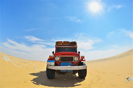 Four Wheel Drive Car in Desert with Sun, Matruh Governorate, Libyan Desert, Sahara Desert, Egypt, Africa Stock Photo - Rights-Managed, Code: 700-07279258