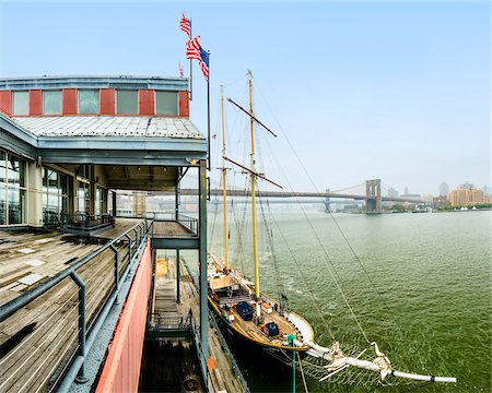 View of schooner docked at Pier 17, Brooklyn Bridge and Manhattan Bridge in the distance, Lower Manhattan, Manhattan, New York City, New York, USA Stock Photo - Rights-Managed, Code: 700-07310304