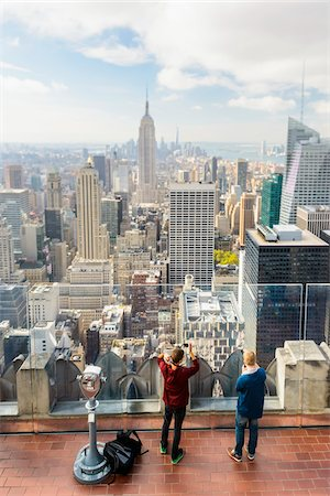 South Manhattan view of skyline with people at Top of the Rock Observation Deck, Rockefeller Center, Midtown, Manhattan, New York City, New York, USA Stock Photo - Rights-Managed, Code: 700-07310317