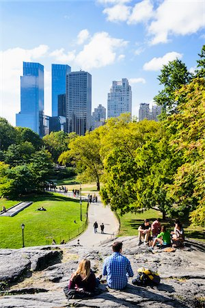 People enjoying Central Park with highrise buildings in background, Midtown Manhattan, New York City, New York, USA Stock Photo - Rights-Managed, Code: 700-07310895