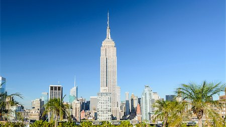 Empire State building seen from 230 Fifth rooftop bar, Midtown Manhattan, New York City, New York, USA Stock Photo - Rights-Managed, Code: 700-07310909