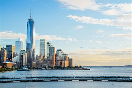 sky - Pier on Hudson River with view of downtown west skyline, World Financial Center and One World Trade Center on the left at sunset, Lower Manhattan, New York City, New York, USA Stock Photo - Rights-Managed, Code: 700-07310915