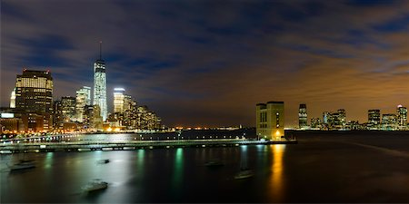 Pier and marina on Hudson River with view of downtown west, Lower Manhattan skyline, New York City, New York, at night, World Financial Center and One World Trade Center on the left, and Jersey City, New Jersey, on right, USA Stock Photo - Rights-Managed, Code: 700-07310918
