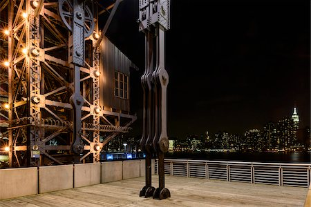 Close-up of restored gantries with view towards Manhattan skyline at night, Gantry Plaza State Park, Queen's, Long Island, New York City, New York, USA Stock Photo - Rights-Managed, Code: 700-07310921