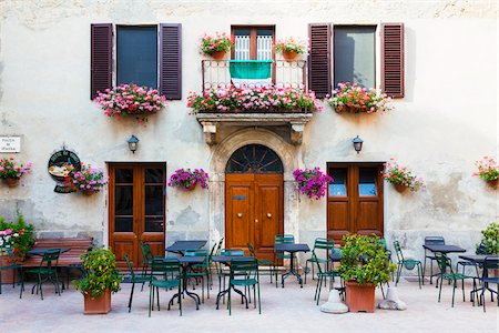 Window Flower Boxes and Planters by Tables in front of Closed Cafe, Pienza, Siena, Val d'Orcia, Tuscany, Italy Stock Photo - Rights-Managed, Code: 700-07311217