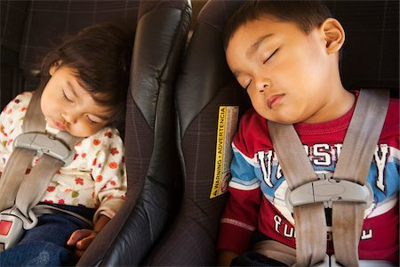 Close-up of toddler siblings napping in their child safety car seats, USA Stock Photo - Rights-Managed, Code: 700-07311590