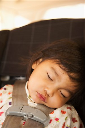 Close-up of toddler girl sleeping in child safety seat, USA Stock Photo - Rights-Managed, Code: 700-07311591