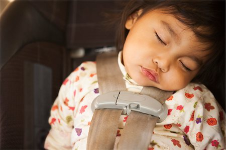 Close-up of toddler girl sleeping in child safety seat, USA Stock Photo - Rights-Managed, Code: 700-07311592